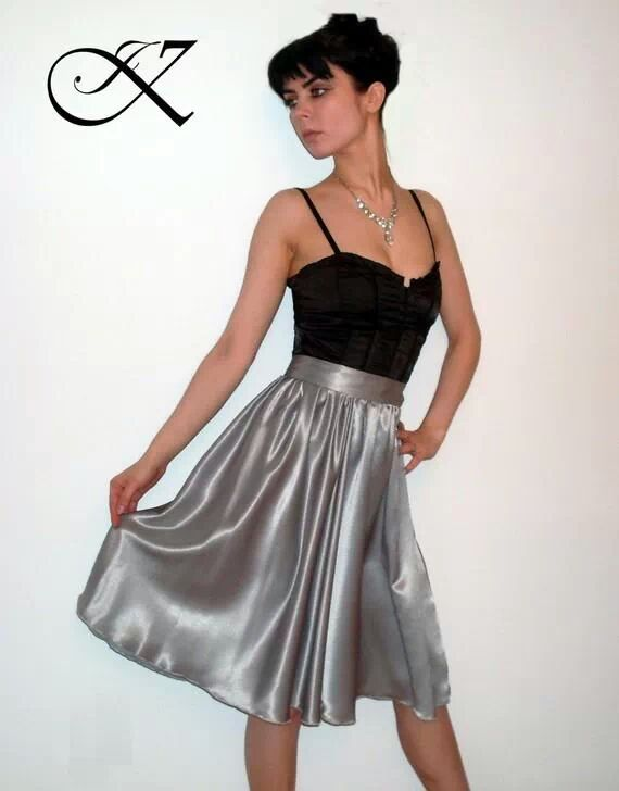 Jennifer Kaya fashion design: black top with silver skirt